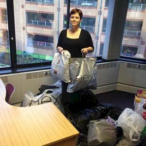 Jane wading through the clothing donation